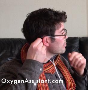 Man putting on nasal cannula