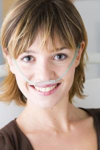 image of woman supplementing oxygen through a nasal cannula